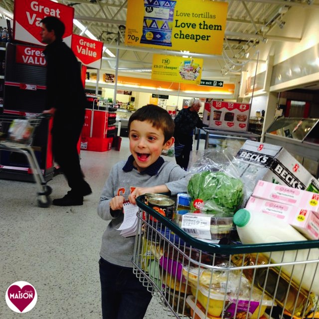 Morrisons trolley full of groceries with six year old