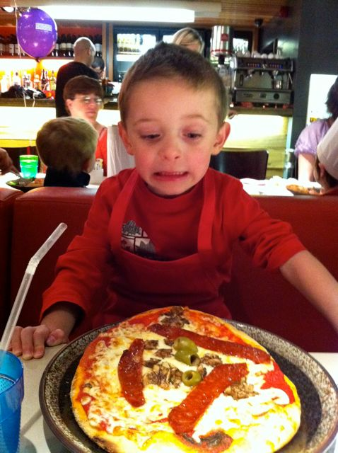 Ted and his pizza at Fire and Stone
