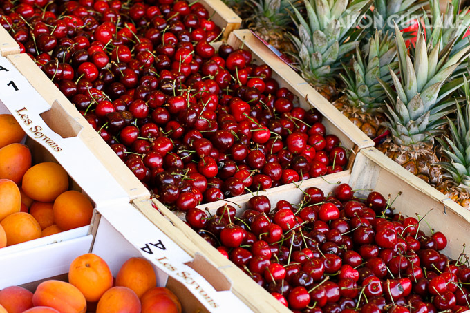 Close up of cherries and fruit for sale at French market stall