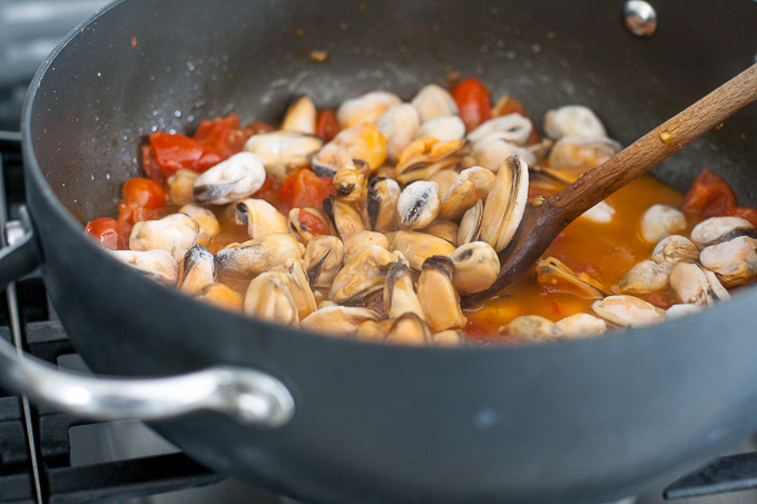 Cooking mussels and mini plum tomatoes