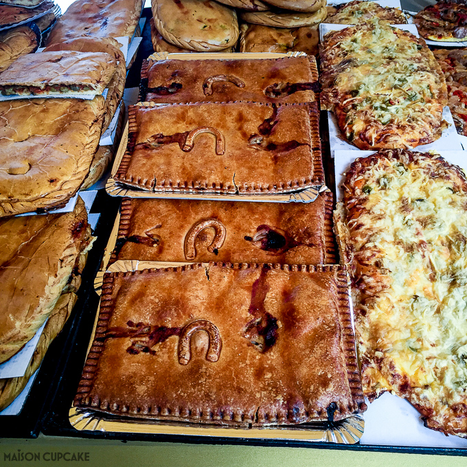 Barcelona street market stall selling horseshoe pastries
