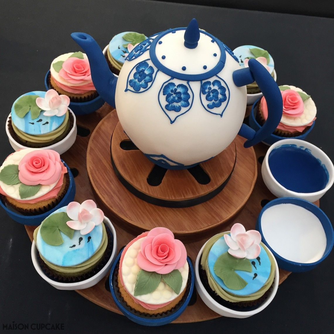 Teapot with floral cupcakes