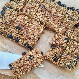 Twelve raisin flapjacks cut into rectangles