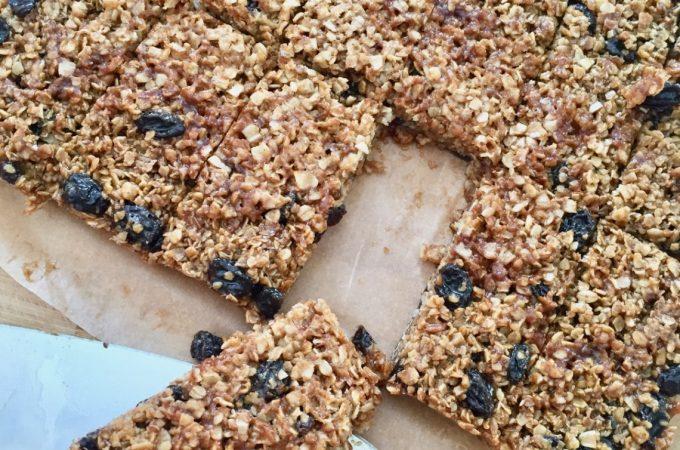 Twelve raisin flapjacks cut into rectangles