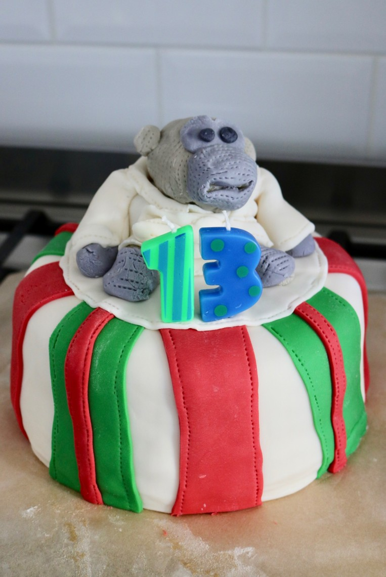 Sugarpaste birthday cake with monkey character and age 13 candles landscape
