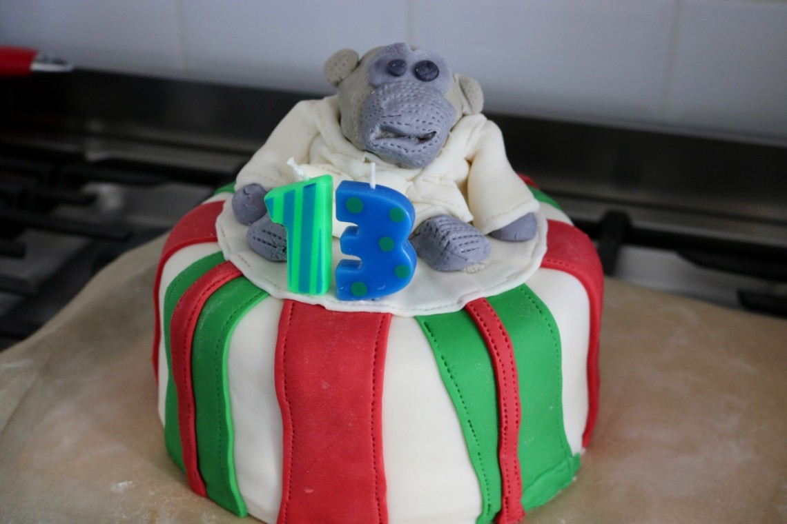 Sugarpaste birthday cake with monkey character and age 13 candles portrait