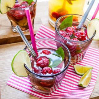 Quench your thirst this summer with this quick and easy refreshing cocktail mocktail idea - iced green tea fruit cup raspberry drink with lime and basil perfect for parties and barbecues